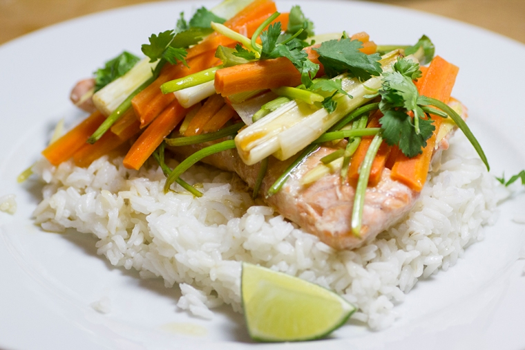 Thai-inspired healthy vegetable salmon dinner with carrot, cilantro, green onion