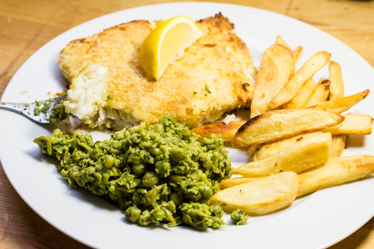 Traditional British dinner - fish & chips with mushy peas