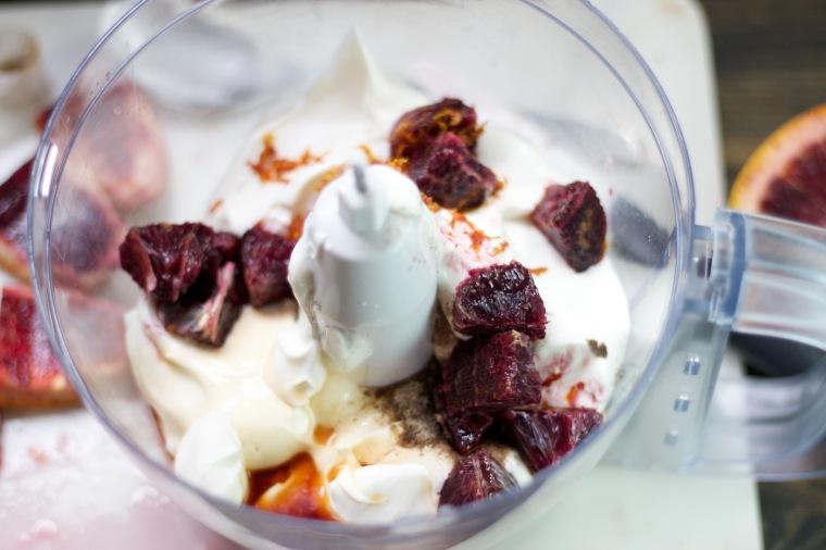 Mixing up blood orange cardamom frozen yogurt on handful of sunshine